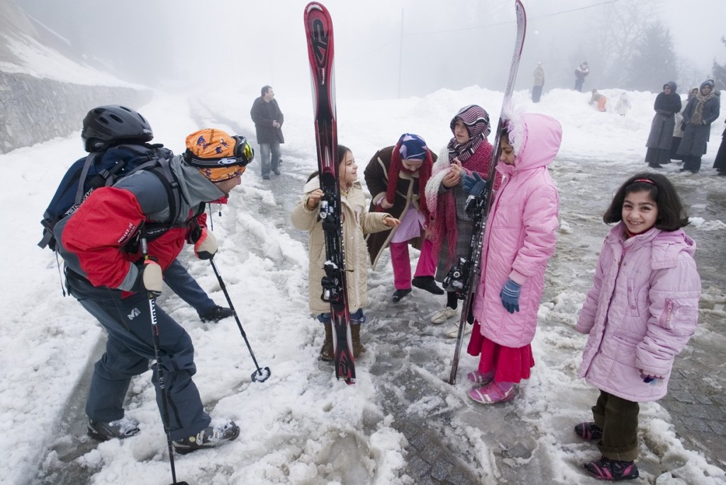 spanish skier Nacho Ferrer Catena playing with young turkish kids near the village of Ayder. Photo: Benoît Vollmer